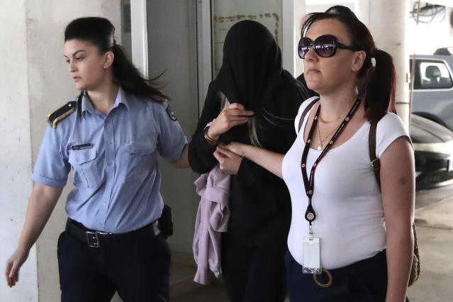 The 19-year-old British woman, centre, pictured in Paralimni, Cyprus, in July, was convicted on Monday morning. (PA)