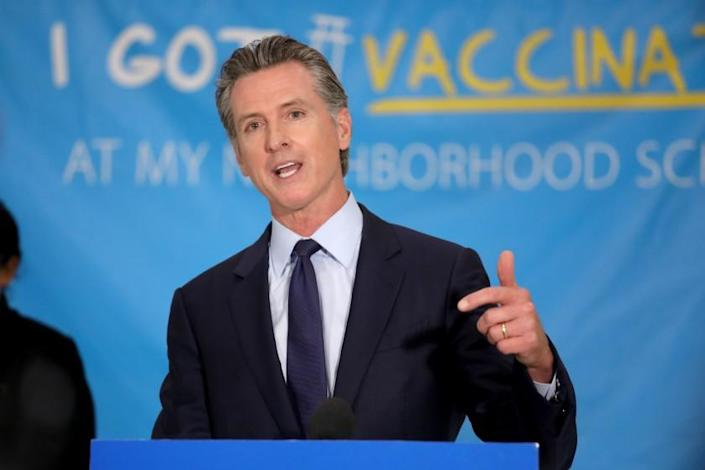 LOS ANGELES, CA - MAY 27: Governor Gavin Newsom unveils a $116.5 million COVID-19 vaccine incentive plan, including cash prizes and gift cards at Esteban Torres High School, a COVID-19 vaccination site, on Thursday, May 27, 2021 in Los Angeles, CA. New efforts by the state to encourage more Californians - especially those in communities that have been hit hardest by the pandemic - to get vaccinated. (Gary Coronado / Los Angeles Times)
