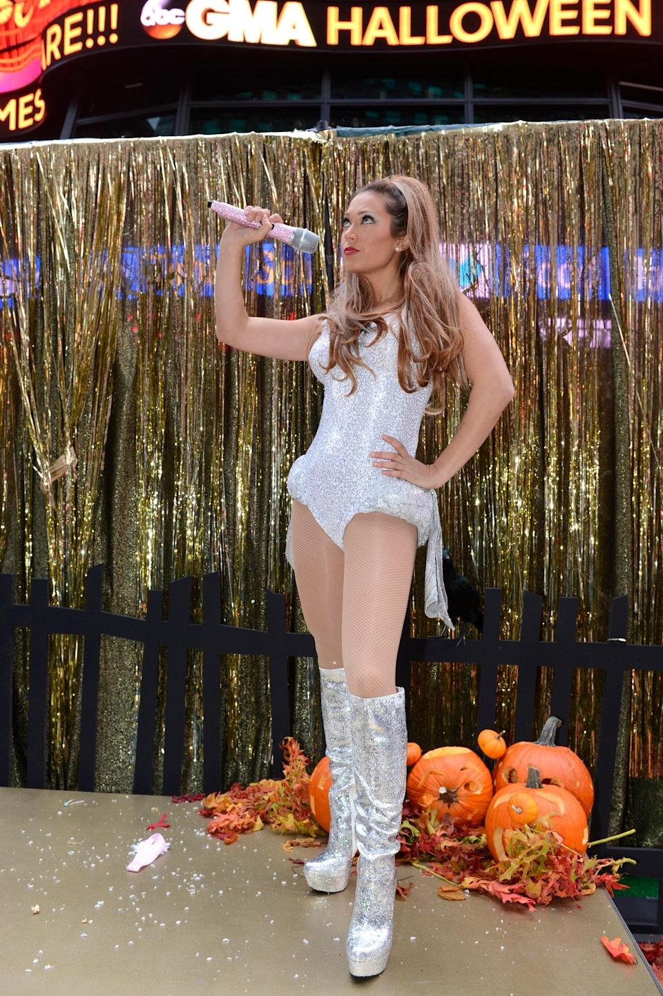 """Morning television hosts love Halloween. Proof: Take a look at <em>Good Morning America</em>'s Ginger Zee as <a href=""""http://www.glamour.com/about/ariana-grande?mbid=synd_yahoo_rss"""" rel=""""nofollow noopener"""" target=""""_blank"""" data-ylk=""""slk:Ariana Grande"""" class=""""link rapid-noclick-resp"""">Ariana Grande</a>, complete with her signature half-up, half-down hairdo. If you're inspired to dress up as Grande this year, you'll need a high ponytail (or a wig), a leotard, and knee-high boots."""