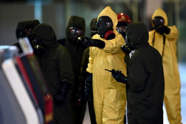 A hazmat team conducts a decontamination operation at Kuala Lumpur International Airport on February 26, 2017