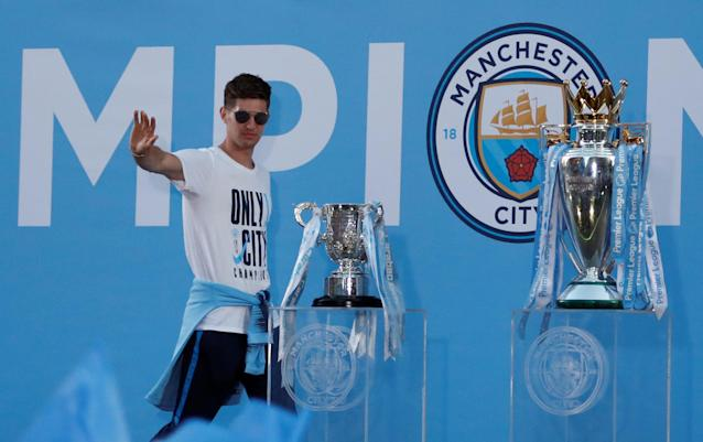 Soccer Football - Premier League - Manchester City Premier League Title Winners Parade - Manchester, Britain - May 14, 2018 Manchester City's John Stones on stage during the parade Action Images via Reuters/Andrew Boyers