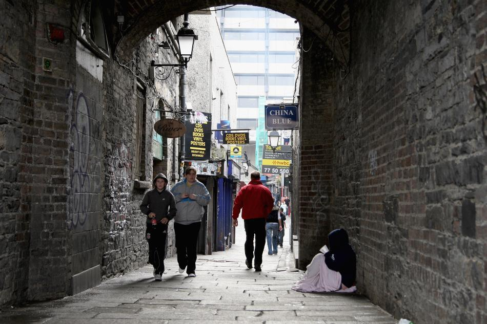 People walk through an area of Temple Bar in Dublin, Ireland.
