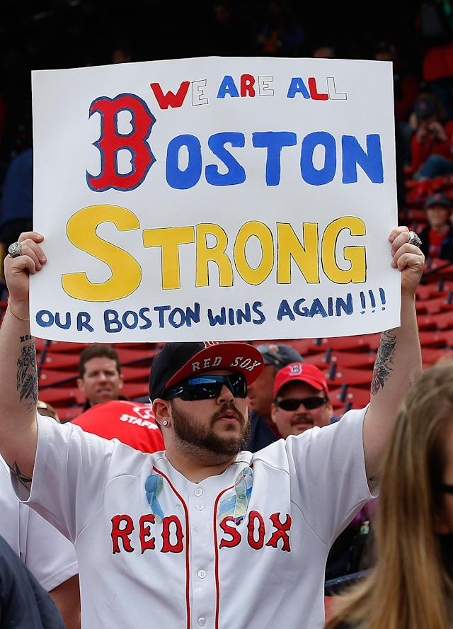 BOSTON, MA - APRIL 20: A fans holds a sign to honor the Marathon bombing victims, before a game the Kansas City Royals at Fenway Park on April 20, 2013 in Boston, Massachusetts. (Photo by Jim Rogash/Getty Images)