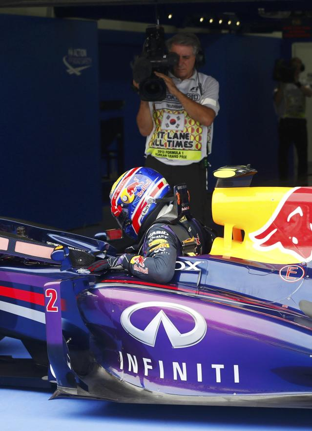 Red Bull Formula One driver Mark Webber of Australia gets out of his car after the qualifying session for the Korean F1 Grand Prix at the Korea International Circuit in Yeongam, October 5, 2013. REUTERS/Kim Hong-Ji (SOUTH KOREA - Tags: SPORT MOTORSPORT F1)