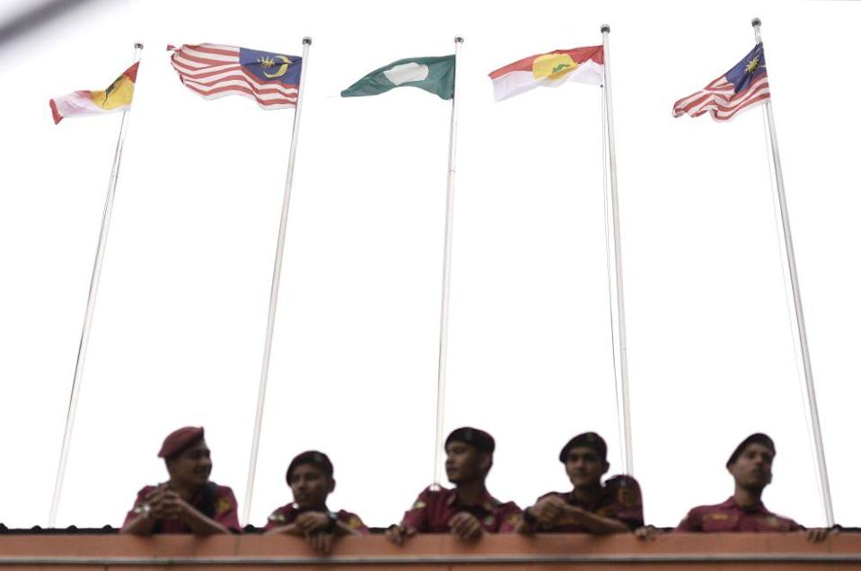 PAS and Umno flags are pictured outside the KL World Trade Centre in Kuala Lumpur September 13, 2019. — Picture by Miera Zulyana
