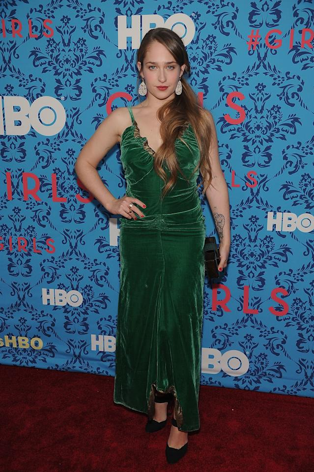 <p>Judging by her red carpet choices, Kirke favors luxe textures like velvet and silk — here, she wears a hunter green velvet slip for the premiere of <em>Girls</em> hosted by the Cinema Society in New York, New York, April 2012.</p>