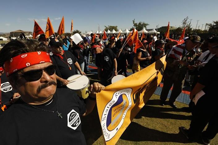 """LOS ANGELES, CA - NOVEMBER 9, 2019 - - Eliseo Ligorea, left, with Los Angeles County Federation of Labor AFL-CIO, joins hundreds who attend the, """"Rally for Justice Immigrant Rights and Equality - 25 years beyond Proposition 187,"""" at the Los Angeles State Historic Park in Los Angeles on November 9, 2019. State Senator Maria Elena Durazo, U.S. Congresswoman Lucille Roybal Allard, Los Angeles Mayor Eric Garcetti, and many members of Los Angeles City Council spoke at the rally. Prop. 187 aimed to block undocumented immigrants from using non-emergency health care, public education and other services in the State of California. Federal courts denied it from ever being implemented. (Genaro Molina / Los Angeles Times)"""