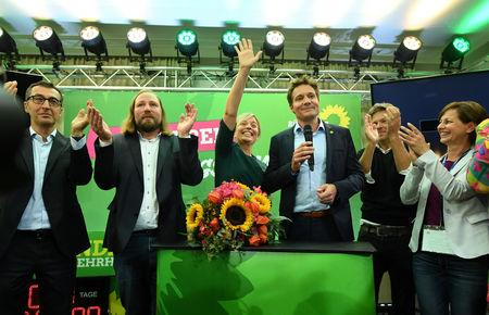 Katharina Schulze and Ludwig Hartmann top candidates of the Green Party celebreate with the other party members after the announcement of first exit polls in the Bavarian state elections in Munich, Germany, October 14, 2018. REUTERS/Andreas Gebert