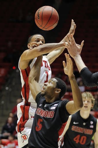 Utah guard Glen Dean, top, knocks the ball loose from Stanford guard Chasson Randle (5) during the first half of an NCAA college basketball game, Sunday, Jan. 27, 2013, in Salt Lake City. (AP Photo/Steve C. Wilson)