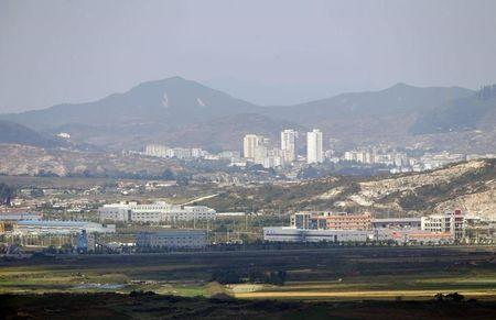 Kaesong city is seen behind the inter-Korean Kaesong Industrial Complex, across the DMZ separating North Korea from South Korea in this picture taken from Dora observatory in Paju