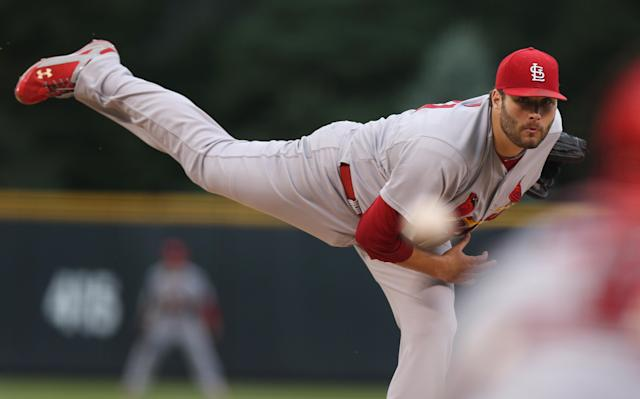St. Louis Cardinals starting pitcher Lance Lynn delivers a pitch against the Colorado Rockies in the first inning of a baseball game in Denver on Monday, June 23, 2014. (AP Photo/David Zalubowski)