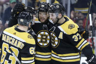 Boston Bruins right wing David Pastrnak celebrates his goal against the Columbus Blue Jackets with teammates Brad Marchand (63) and Patrice Bergeron (37) in the second period of an NHL hockey game, Thursday, Jan. 2, 2020, in Boston. (AP Photo/Elise Amendola)