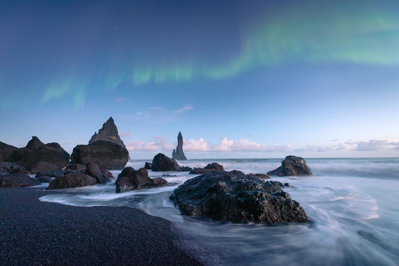 """<p>While the aurora borealis may be a stunning backdrop, the <a rel=""""nofollow"""" href=""""https://guidetoiceland.is/travel-iceland/drive/reynisfjara"""">basalt columns</a> look especially eerie when covered with fog rolling off the Atlantic. And tourists, be warned – the waves are known for being unpredictable. </p>"""