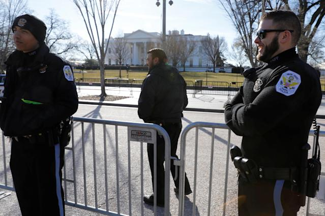 <p>U.S. Park Police officers stand outside the White House at the first day of government shutdown in Washington, Jan. 20, 2018. (Photo: Yuri Gripas/Reuters) </p>