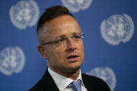 Peter Szijjarto, Hungary's minister of foreign affairs and trade, speaks during an interview with the Associated Press at United Nations headquarters, Thursday, Sept. 23, 2021, during the 76th Session of the U.N. General Assembly in New York. (AP Photo/John Minchillo)