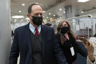 Sen. Pat Toomey, R-Pa., departs on Capitol Hill in Washington, Saturday, Feb. 13, 2021, after the Senate acquitted former President Donald Trump in his second impeachment trial in the Senate at the U.S. Capitol in Washington, Saturday, Feb. 13, 2021. Trump was accused of inciting the Jan. 6 attack on the U.S. Capitol, and the acquittal gives him a historic second victory in the court of impeachment. (AP Photo/Alex Brandon)