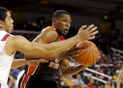 Oregon State guard Langston Morris-Walker, right, drives on Southern Cal forward Aaron Fuller, left, as he battles to the basket during the first half of an NCAA college basketball game, Saturday, Jan. 19, 2013, in Los Angeles. (AP Photo/Gus Ruelas)