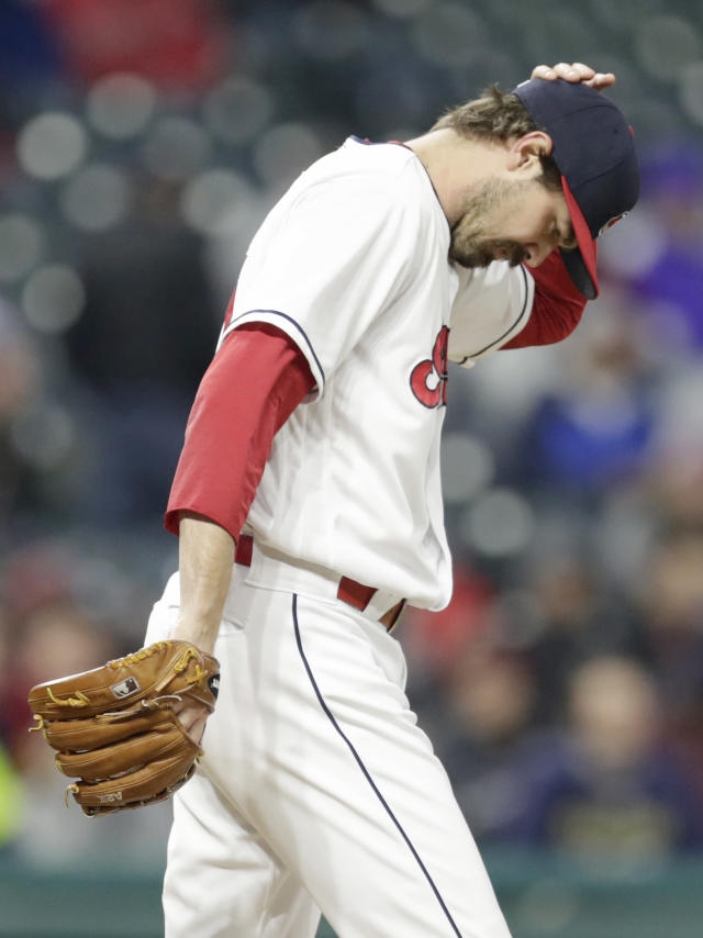 Cleveland Indians relief pitcher Andrew Miller reacts after Kansas City Royals' Salvador Perez hit a two-run home run during the seventh inning of a baseball game Friday, May 11, 2018, in Cleveland. (AP Photo/Tony Dejak)