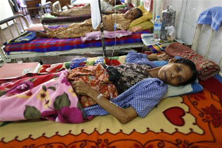 Women lie in a ward as they get treatment in Muslims Charity hospital in Yangon