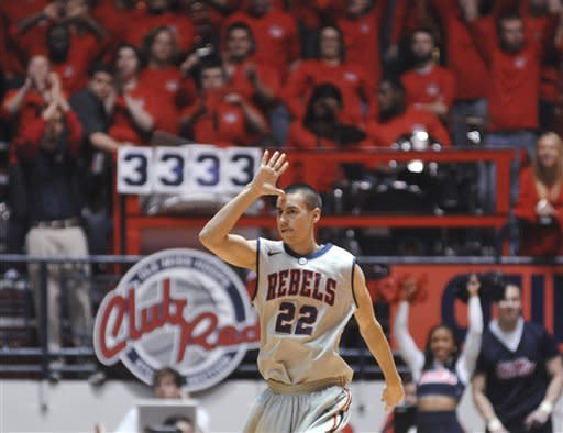Mississippi's Marshall Henderson reacts to making a 3-pointer against Mississippi State during an NCAA college basketball game Wednesday, Feb. 6, 2013, in Oxford, Miss. Mississippi won 93-75. (AP Photo/Oxford Eagle, Bruce Newman)