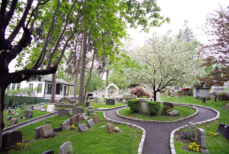 "This 2011 photo provided by the Hartsdale Pet Cemetery in Whtie Plains, N.Y., shows a scenic view of the first burial ground for animals named to the National Register of Historic Places. The 116-year-old Hartsdale Pet Cemetery, final home to some 75,000 animals and a few hundred humans, is being designated for its ""social history and landscape architecture."" (AP Photo/Hartsdale Pet Cemetery, Mary Thurston)"