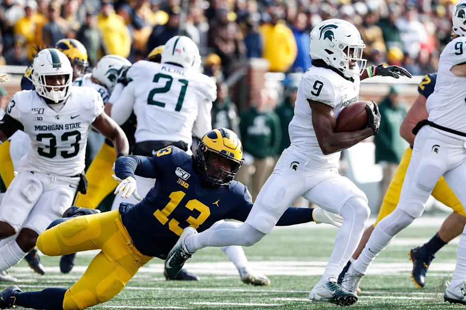 Michigan's Charles Thomas tries to stop Michigan State kick returner Anthony Williams Jr. during the first half at Michigan Stadium in Ann Arbor, Saturday, Nov. 16, 2019.