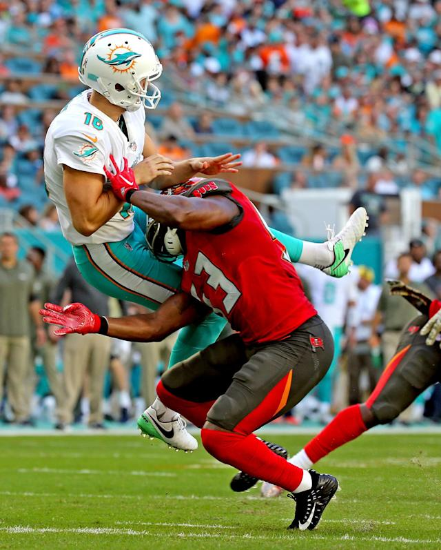 <p>Miami Dolphins kicker Matt Haack (16) is hit by Tampa Bay Buccaneers' Adarius Glanton (53) on Sunday, Nov. 19, 2017 at Hard Rock Stadium in Miami Gardens, Fla. (Charles Trainor Jr./Miami Herald/TNS) </p>