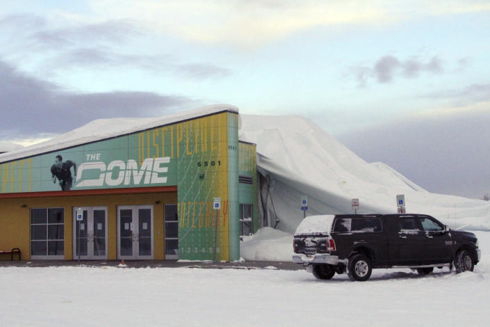 The Dome, a 180,000-square foot indoor sports facility in Anchorage, Alaska, is seen on Tuesday, Jan. 24, 2017, three days after the thin, flexible plastic roof collapsed in the midst of a snowstorm. The facility is among others, including an old lumber mill in Oregon, the main grocery store in a small Idaho town, and a conference center in Colorado that have collapsed under the accumulated weight of snow this winter. (AP Photo/Mark Thiessen)