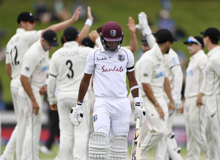 The West Indies' Kraigg Brathwaite walks off after being dismissed by New Zealand's Trent Boult during play on day three of their first cricket test in Hamilton, New Zealand, Saturday, Dec. 5, 2020. (Andrew Cornaga/Photosport via AP)