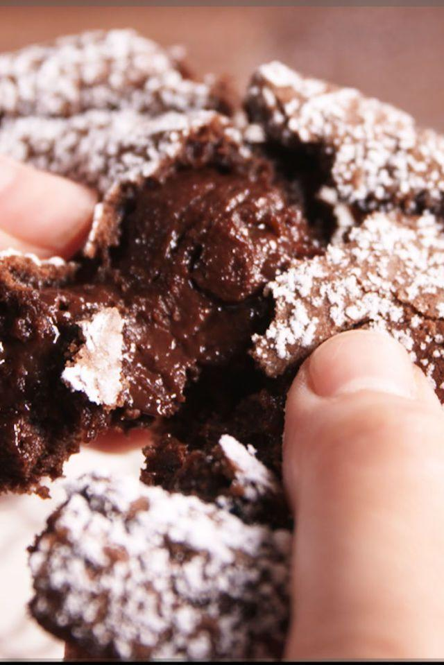 """<p>A simple chocolate batter houses a gooey truffle that will make you the MVP of Valentine's Day.</p><p><em><a href=""""https://www.delish.com/cooking/recipe-ideas/recipes/a49111/chocolate-truffle-cupcakes-recipe/"""" rel=""""nofollow noopener"""" target=""""_blank"""" data-ylk=""""slk:Get the recipe from Delish »"""" class=""""link rapid-noclick-resp"""">Get the recipe from Delish »</a></em></p>"""