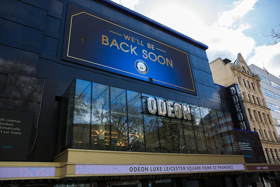 Odeon Cinema Home of Premieres in Leicester Square seen with a huge billboard reading