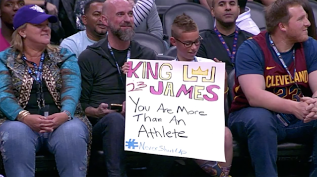 """<p>LeBron James likely made this kid's year after giving him his arm sleeve in the final minutes of Tuesday's game against the Suns. </p><p>In the game's final minutes, James took off the sleeve and gave it to a young fan sitting courtside who held the sign, """"King James. You are more than an athlete. #NeverShutUp.""""</p><p>Last month, Fox News' Laura Ingraham said James and Kevin Durant should <a href=""""http://www.si.com/nba/2018/02/16/fox-news-laura-ingraham-lebron-james-president-donald-trump-shut-dribble"""" rel=""""nofollow noopener"""" target=""""_blank"""" data-ylk=""""slk:""""shut up and dribble"""""""" class=""""link rapid-noclick-resp"""">""""shut up and dribble""""</a> instead of discussing politics. The <a href=""""http://www.si.com/nba/2018/02/15/lebron-james-donald-trump-comments"""" rel=""""nofollow noopener"""" target=""""_blank"""" data-ylk=""""slk:two had criticized President Donald Trump"""" class=""""link rapid-noclick-resp"""">two had criticized President Donald Trump</a> in a video with ESPN's Cari Champion for the UNINTERRUPTED.</p><p>After Ingraham's comments, James posted this photo to Instagram and <a href=""""https://www.si.com/nba/2018/02/17/lebron-james-kevin-durant-laura-ingraham-comments"""" rel=""""nofollow noopener"""" target=""""_blank"""" data-ylk=""""slk:later talked about her words"""" class=""""link rapid-noclick-resp"""">later talked about her words</a>. </p><p>James finished the Suns' game with 28 points, 13 rebounds and 11 assists?</p>"""