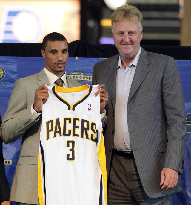 Indiana pacers president Larry Bird, right, poses with new Pacer George Hill after he was introduced in Indianapolis, Monday, June 27, 2011. (AP Photo/Michael Conroy)