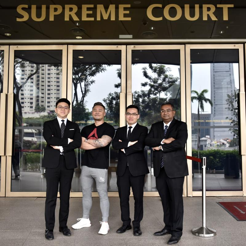 Johnson Ong Ming, a disc jockey and music producer known as DJ Big Kid, with his lawyers.