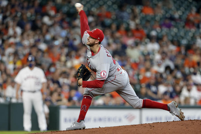 Los Angeles Angels starting pitcher Griffin Canning throws against the Houston Astros during the first inning of a baseball game Saturday, April 24, 2021, in Houston. (AP Photo/Michael Wyke)
