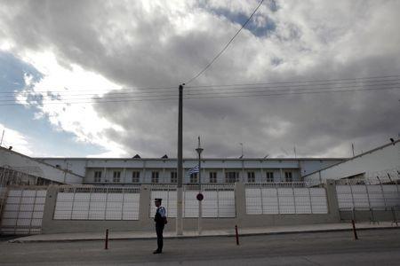 A police officer stands guard outside the Korydallos prison in Athens