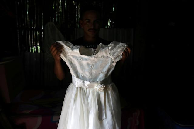 Arnovis Guido Portillo shows a dress of his daughter Maybelline Guido at his home at the Corral de Mulas village in Puerto El Triunfo, El Salvador, June 23, 2018. Arnovis was deported from the USA without his six years old daughter Maybelline. REUTERS/Jose Cabezas TPX IMAGES OF THE DAY