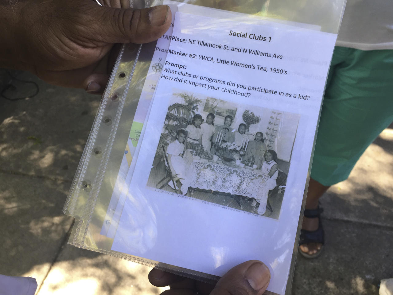 In this photo taken July 6, 2017, a community photo is shown in North Portland, Ore. A study at Oregon Health & Science University uses old community photos as prompts to help test whether reminiscence can help African-American seniors stay sharp and slow early memory loss. (AP Photos/Gillian Flaccus)