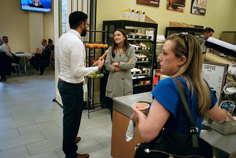 AOC talks with an intern from her office in Au Bon Pain while grabbing lunch. People recognize her nearly everywhere.