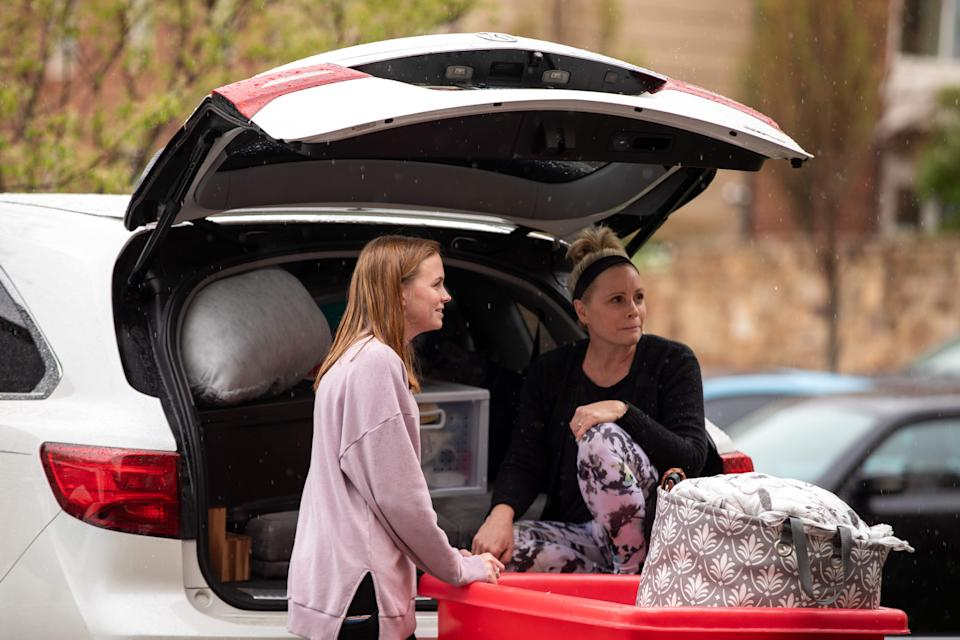 Michelle Gougler, right, helps her daughter Morgan Gougler,a student at Liberty University in Lynchburg, Virginia, move out of her dorm on March 31, 2020. - Virginia's governor on March, 31, 2020 ordered all higher education institutions to halt any in-person instruction amid the coronavirus pandemic, a move likely directed at Liberty University, which initially declined to stop all on-campus teaching. (Photo by Amanda Andrade-Rhoades / AFP) (Photo by AMANDA ANDRADE-RHOADES/AFP via Getty Images)