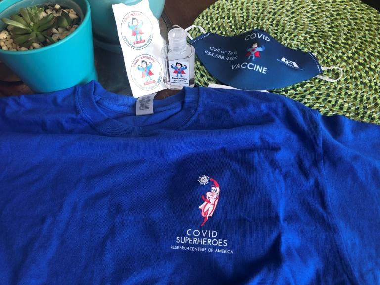"""Vaccine trial participants received t-shirts, masks and stickers Marked """"Covid warriors"""" or """"Covid superheroes"""""""