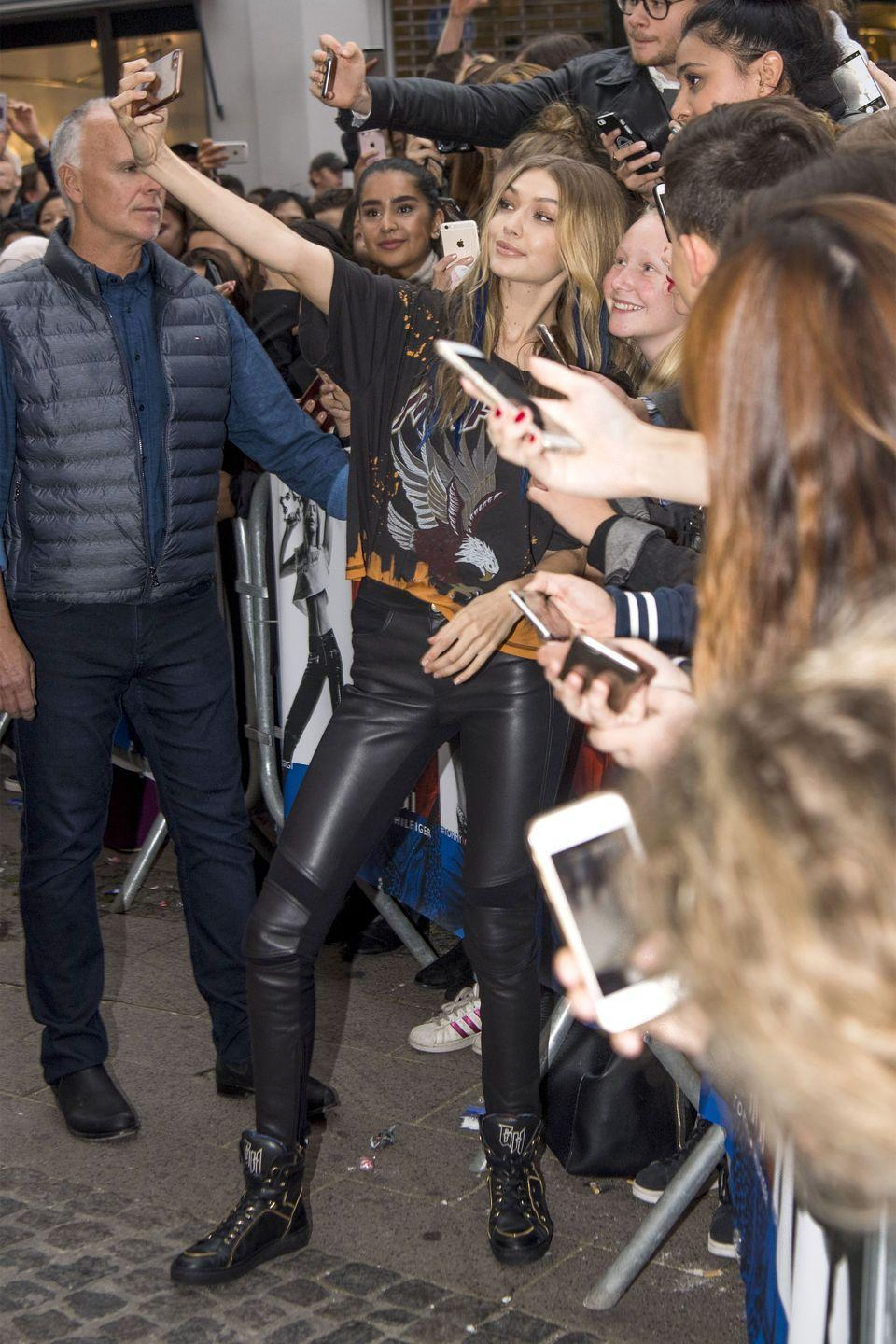 <p>In a Tommy x Gigi graphic tee, leather leggings, and high-top sneakers while meeting fans in Copenhagen. </p>