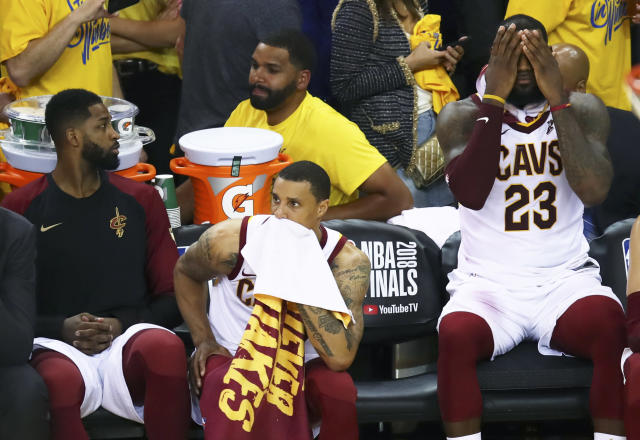 "LeBron James (R) and teammates Tristan Thompson (L) and <a class=""link rapid-noclick-resp"" href=""/nba/players/4488/"" data-ylk=""slk:George Hill"">George Hill</a> absorb their Game 2 loss to the Warriors. (AP)"