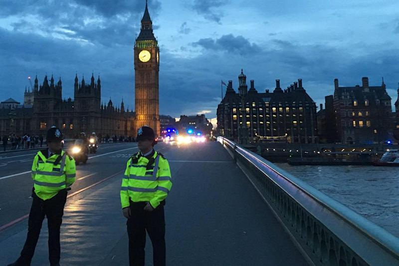 Police cordon: Officers on Westminster Bridge after a man reported 'jumped off': Twitter/Ben Dodd