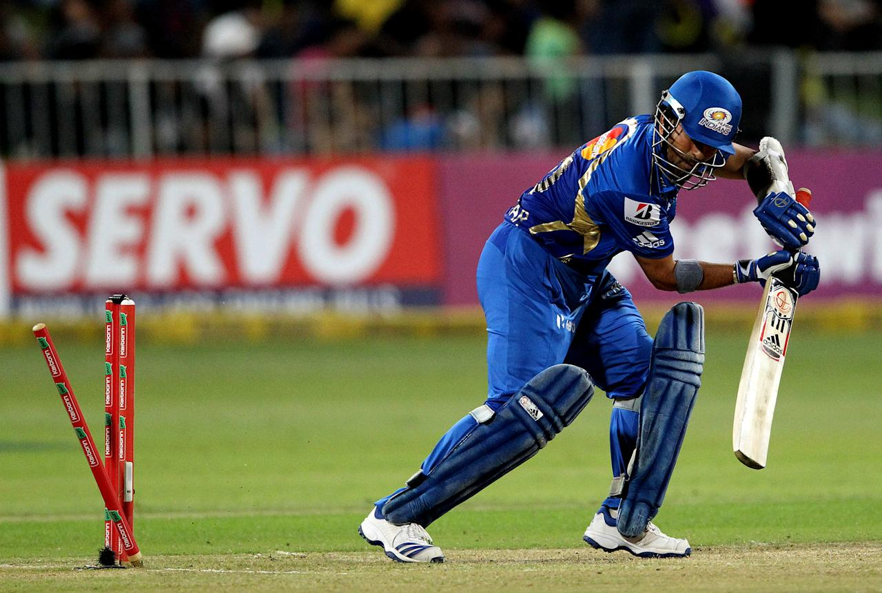 DURBAN, SOUTH AFRICA - OCTOBER 22:  Sachin Tendulkar of Mumbai is bowled during the Champions League twenty20 match between Sydney Sixers and Mumbai Indians at Sahara Stadium Kingsmead on October 22, 2012 in Durban, South Africa. (Photo by Anesh Debiky / Gallo Images/Getty Images)