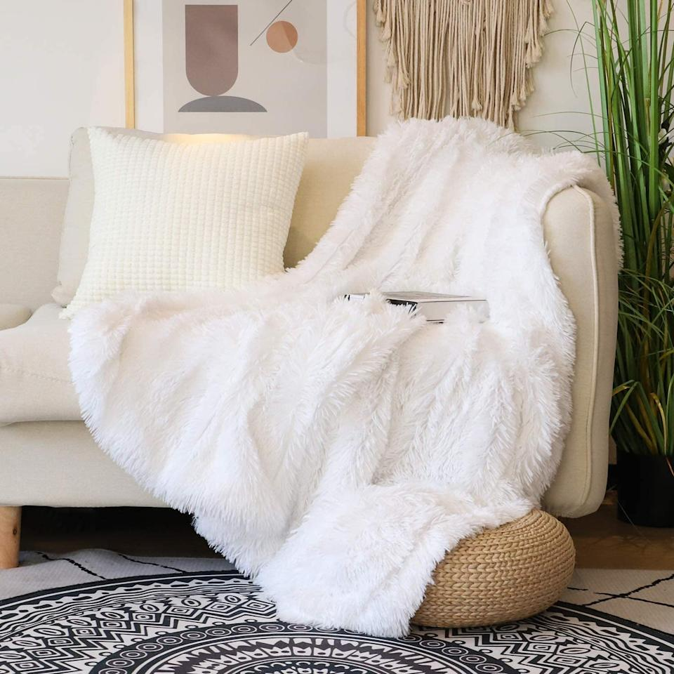 "<p>We can't wait to cuddle up in this <product href=""https://www.amazon.com/Decorative-Blanket-Reversible-Lightweight-Microfiber/dp/B07VN42KTF/ref=sr_1_6?crid=3KU2HDX9W5EB7&amp;dchild=1&amp;keywords=soft+throw+blanket&amp;qid=1599082035&amp;s=home-garden&amp;sprefix=soft+throw%2Cgarden%2C219&amp;sr=1-6"" target=""_blank"" class=""ga-track"" data-ga-category=""internal click"" data-ga-label=""https://www.amazon.com/Decorative-Blanket-Reversible-Lightweight-Microfiber/dp/B07VN42KTF/ref=sr_1_6?crid=3KU2HDX9W5EB7&amp;dchild=1&amp;keywords=soft+throw+blanket&amp;qid=1599082035&amp;s=home-garden&amp;sprefix=soft+throw%2Cgarden%2C219&amp;sr=1-6"" data-ga-action=""body text link"">Decorative Extra Soft Faux Fur Throw Blanket</product> ($20).</p>"