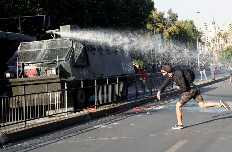 Chile President Pinera declares emergency as capital rocked by riots