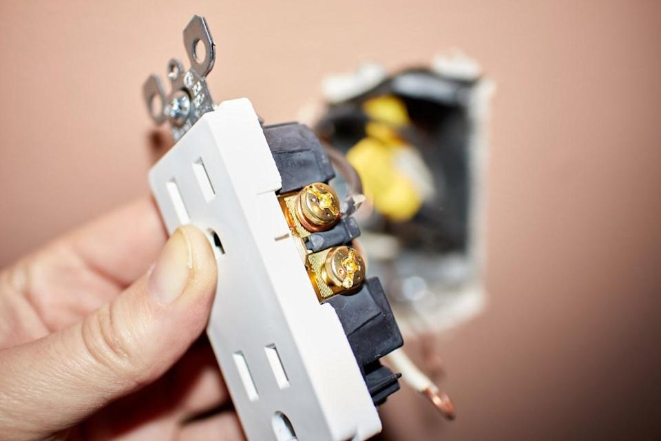 "Ever feel like you're playing a game of Operation trying to plug something into your wall outlets? If so, it's time to call an electrician. Difficulty <a href=""https://www.jaffeelectric.com/blog/fixing-loose-plugs-that-fall-out-of-outlets/"" rel=""nofollow noopener"" target=""_blank"" data-ylk=""slk:plugging your electronics"" class=""link rapid-noclick-resp"">plugging your electronics</a> into your outlets could be a sign that your wiring is loose, which can increase your risk of an electrical fire."