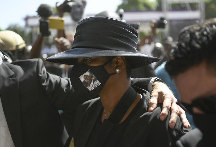 Former first lady of Haiti, Martine Moise, attends the funeral of her slain husband, former President Jovenel Moise, at his family home in Cap-Haitien, Haiti, Friday, July 23, 2021. Martine Moise was injured in the July 7 attack at their private home, and returned to Haiti following her release from a Miami hospital. (AP Photo/Matias Delacroix)