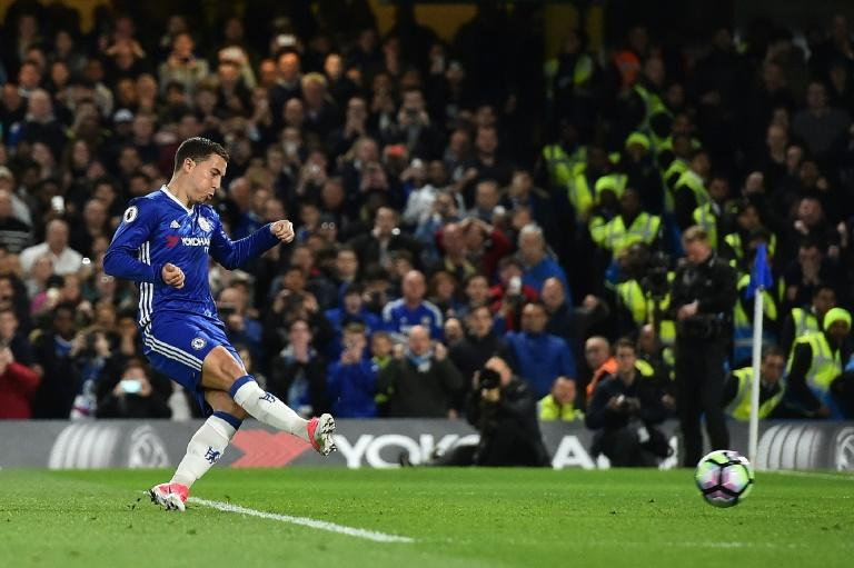 Chelsea's midfielder Eden Hazard scores his team's second goal during the English Premier League football match between Chelsea and Manchester City at Stamford Bridge in London on April 5, 2017